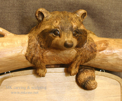 Raccoon sign woodcarving 2