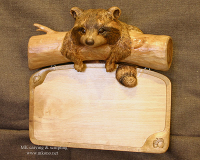 Raccoon sign woodcarving 1
